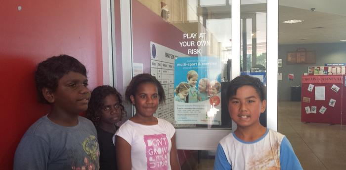 Children representing the diversity of contemporary multicultural Australia stand near a sign depicting an 'idealised' white Australia. Blackwood Recreation Centre, South Australia, 2015. Photo: C. Smith